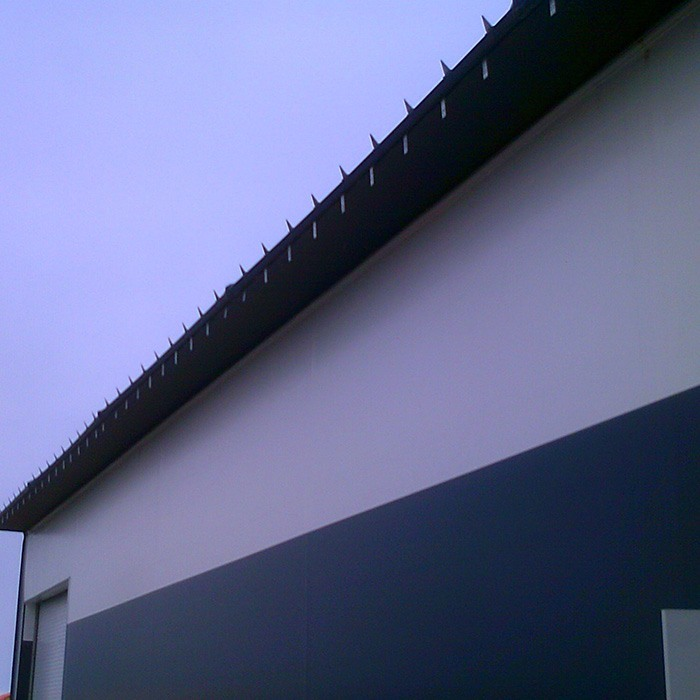 Fabric structure eave extension ice breaker