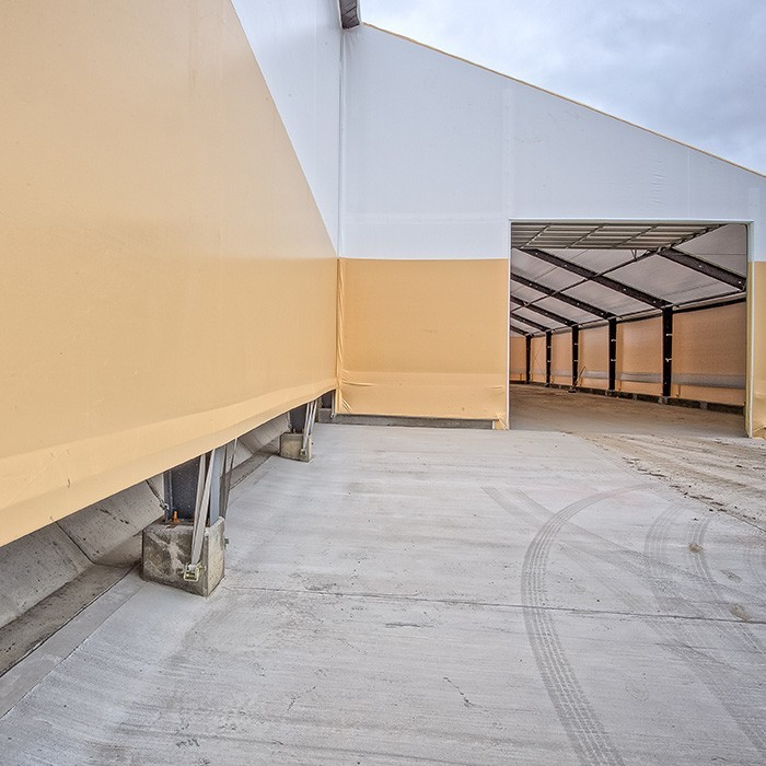 fabric structure sidewall termination lean-to